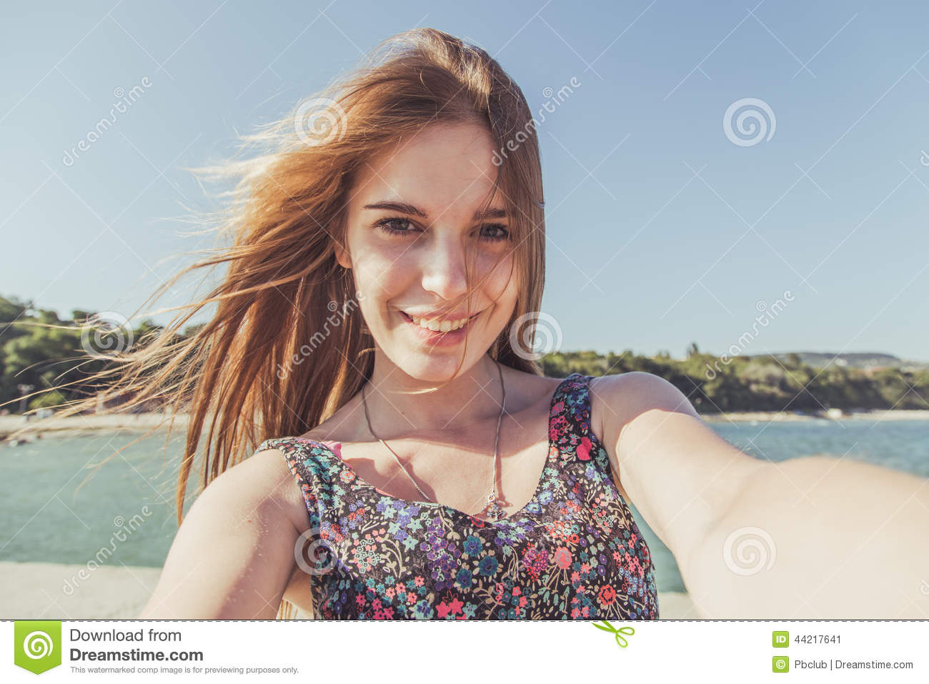 Young woman on the beach looking at camera
