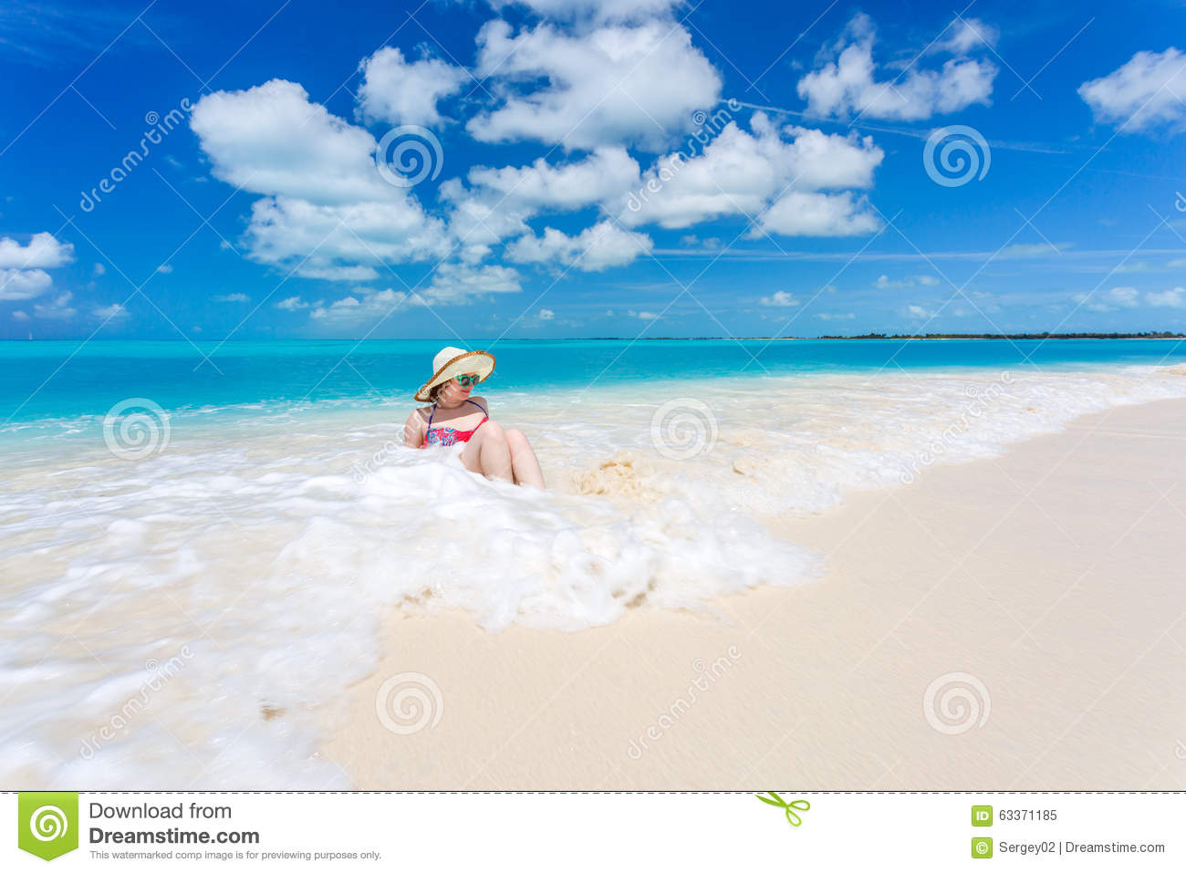Caribbean Relaxation: Young Woman On The Beach Stock Photo