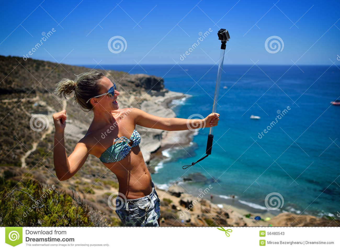 Palm Beach Tan Prices >> Young Woman On The Beach In Summer Using Gopro Stock Image ...