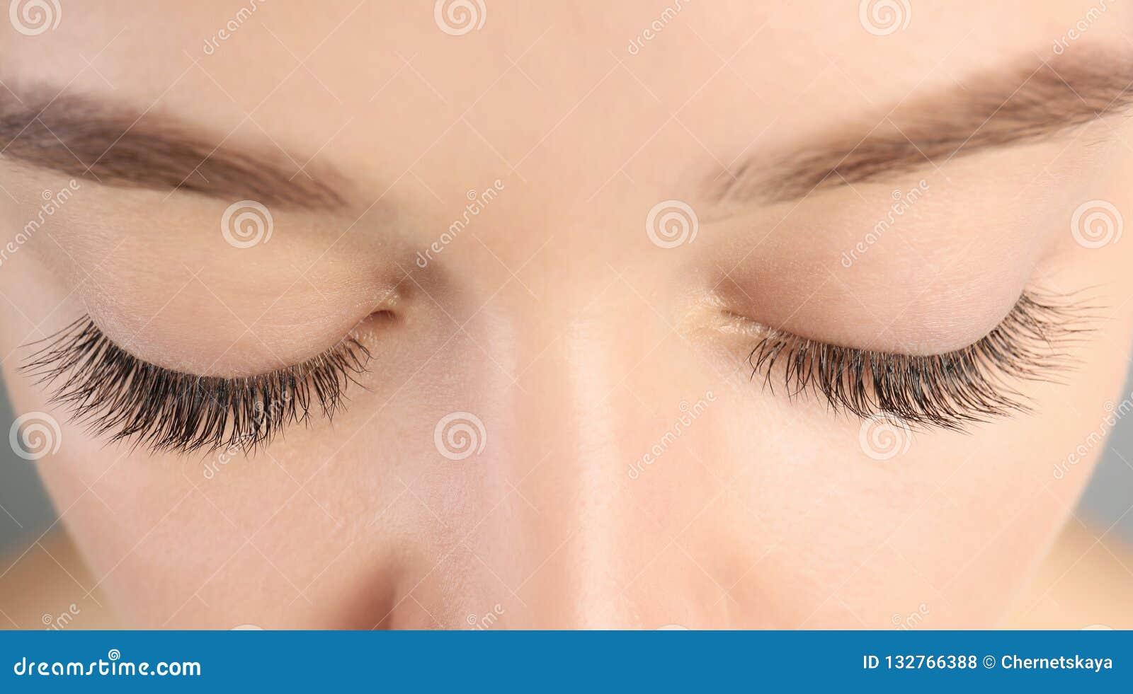 Young woman with beautiful long eyelashes, closeup