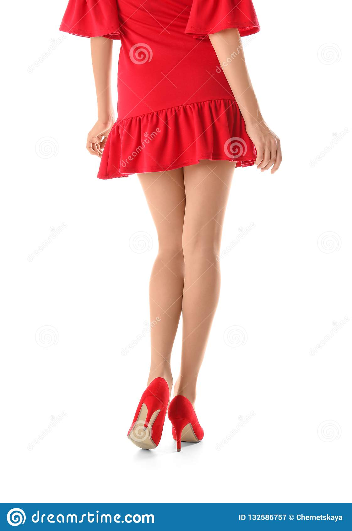 Young woman with beautiful long legs in stylish outfit