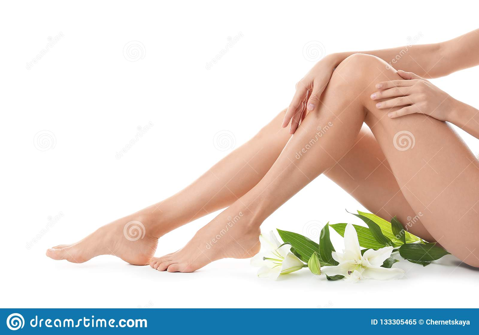 Young woman with beautiful long legs on white background
