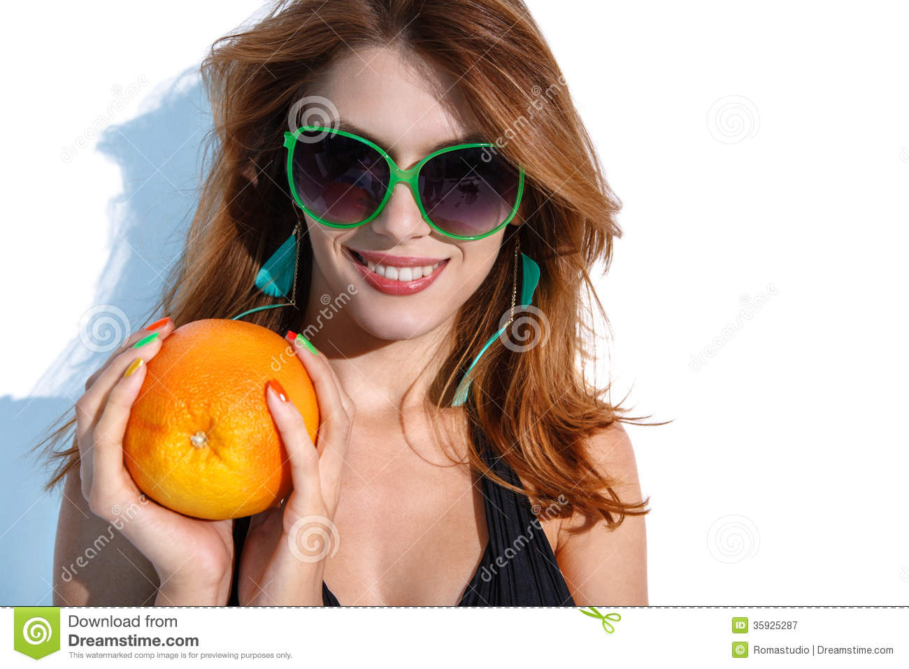Young woman with big orange