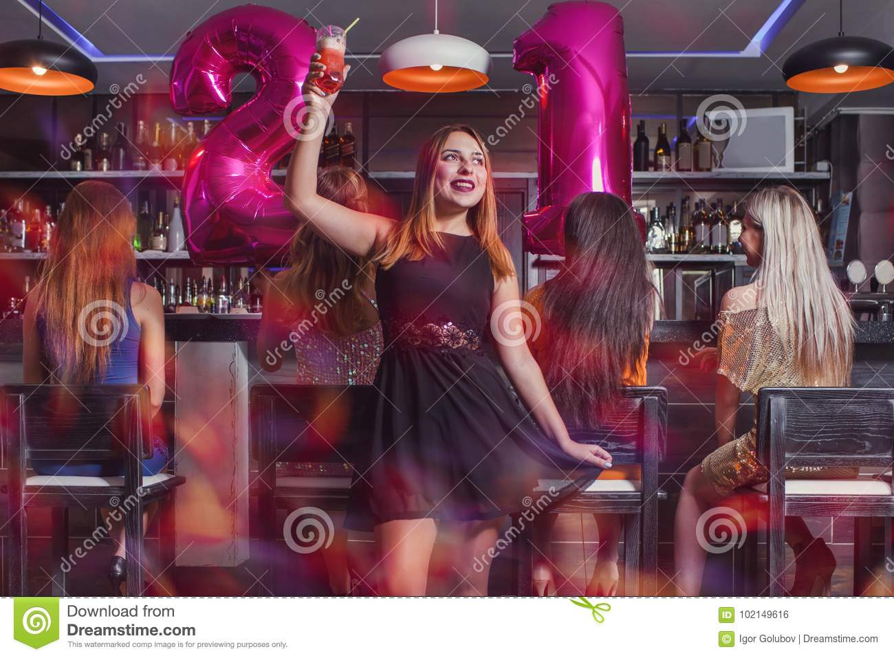 Young woman 21 birthday party in night club
