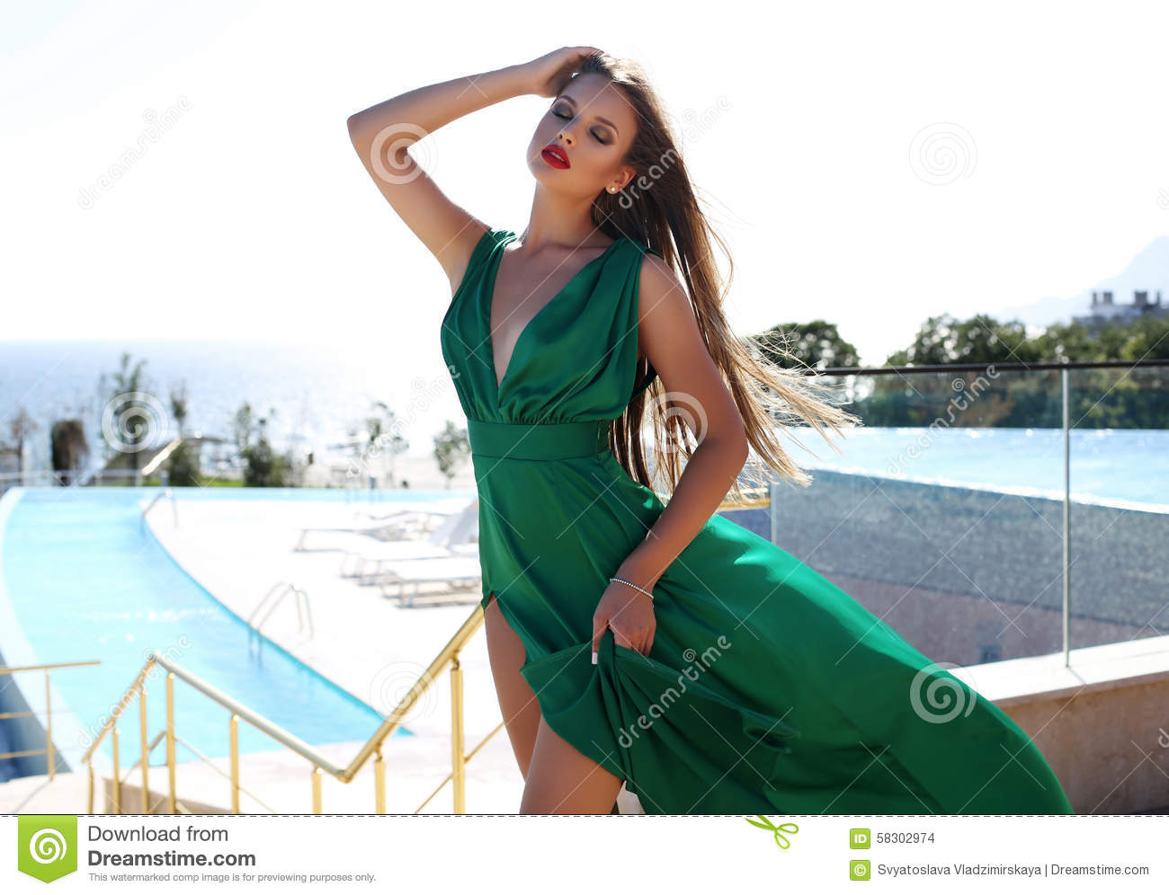 Young Woman With Blond Hair In Luxurious Green Silk Dress Stock Photo Image 58302974