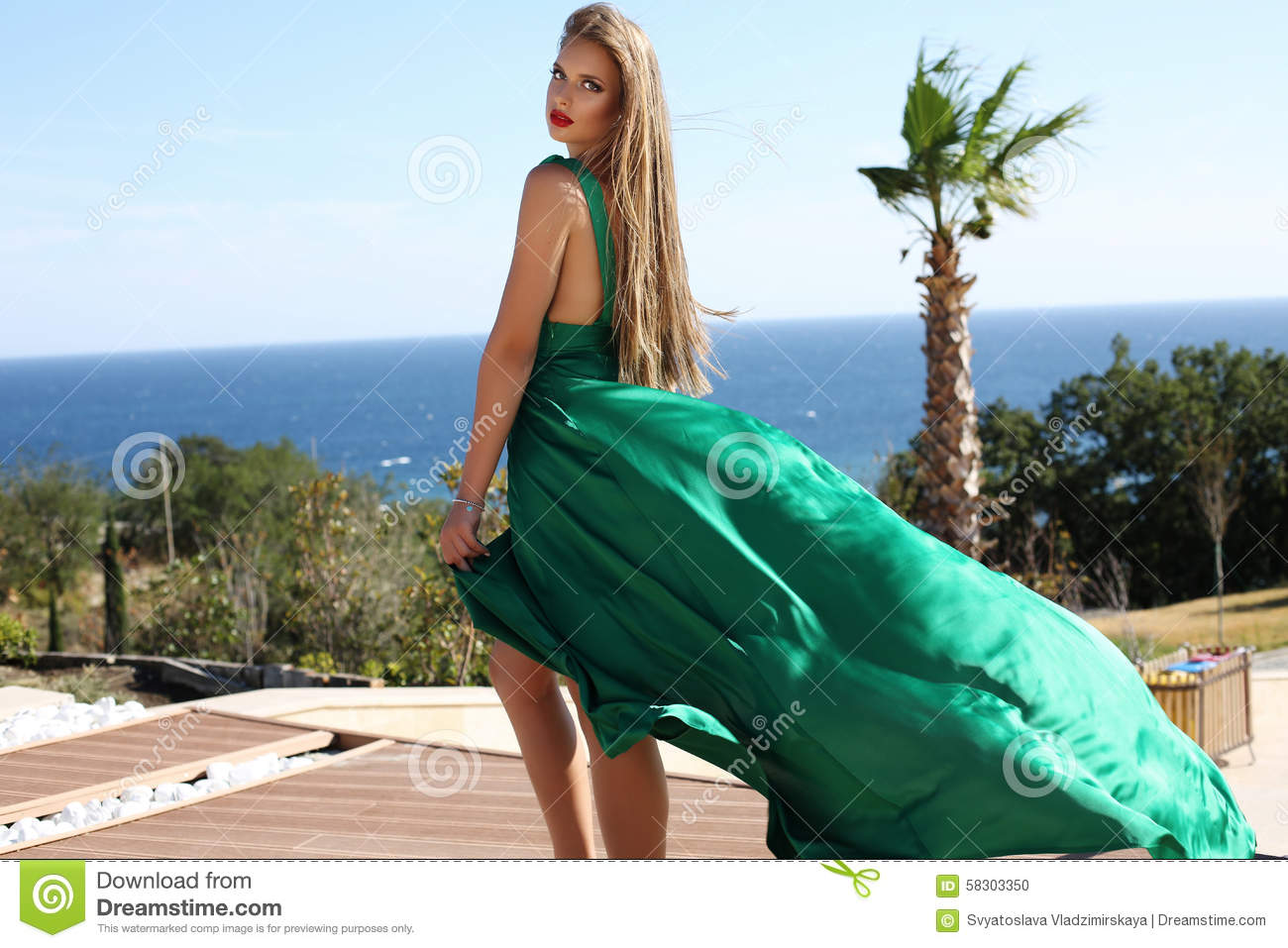 Young Woman With Blond Hair In Luxurious Green Silk Dress Stock Photo Image 58303350