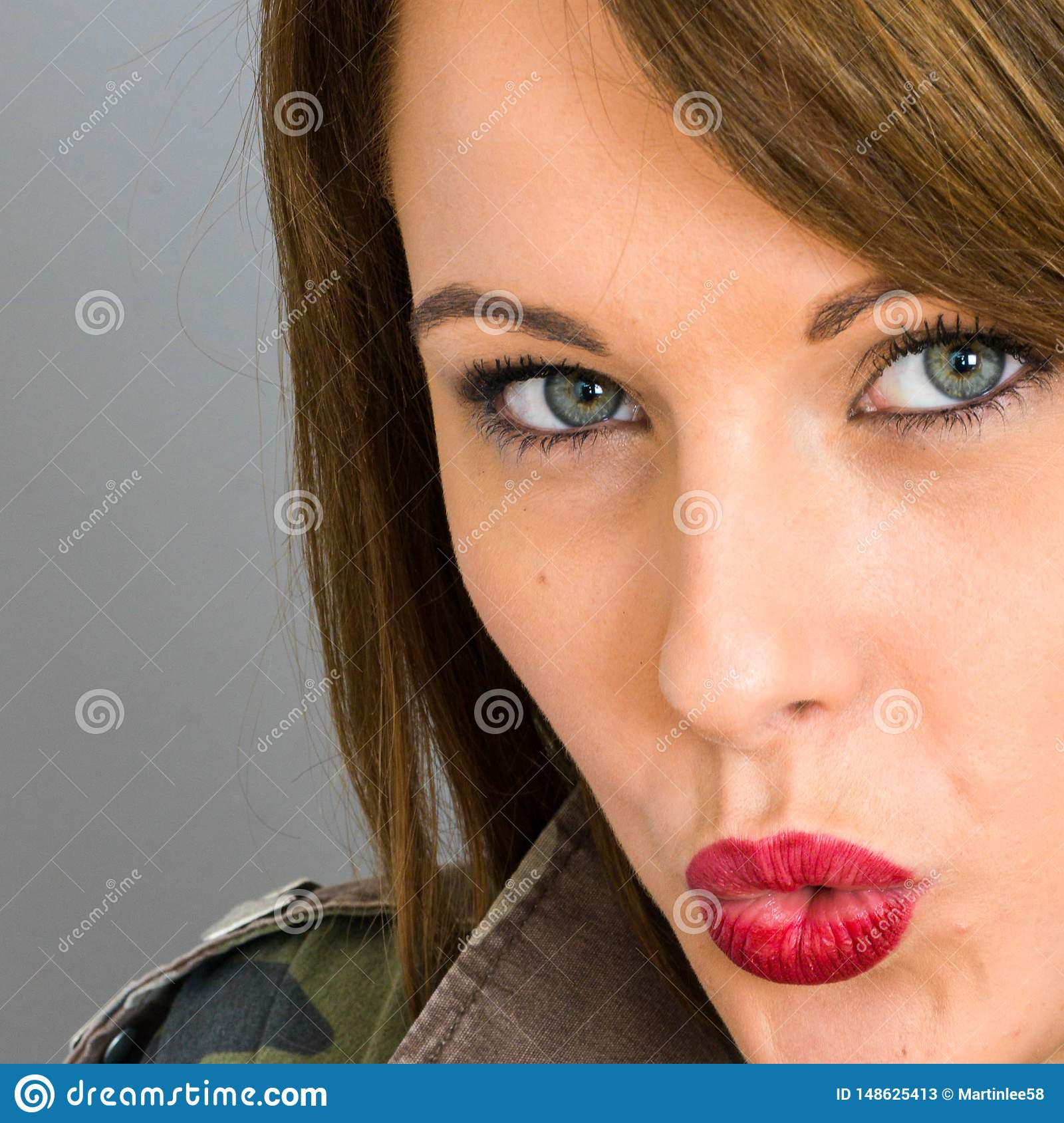 Young Woman Blowing a Kiss Looking Sensual