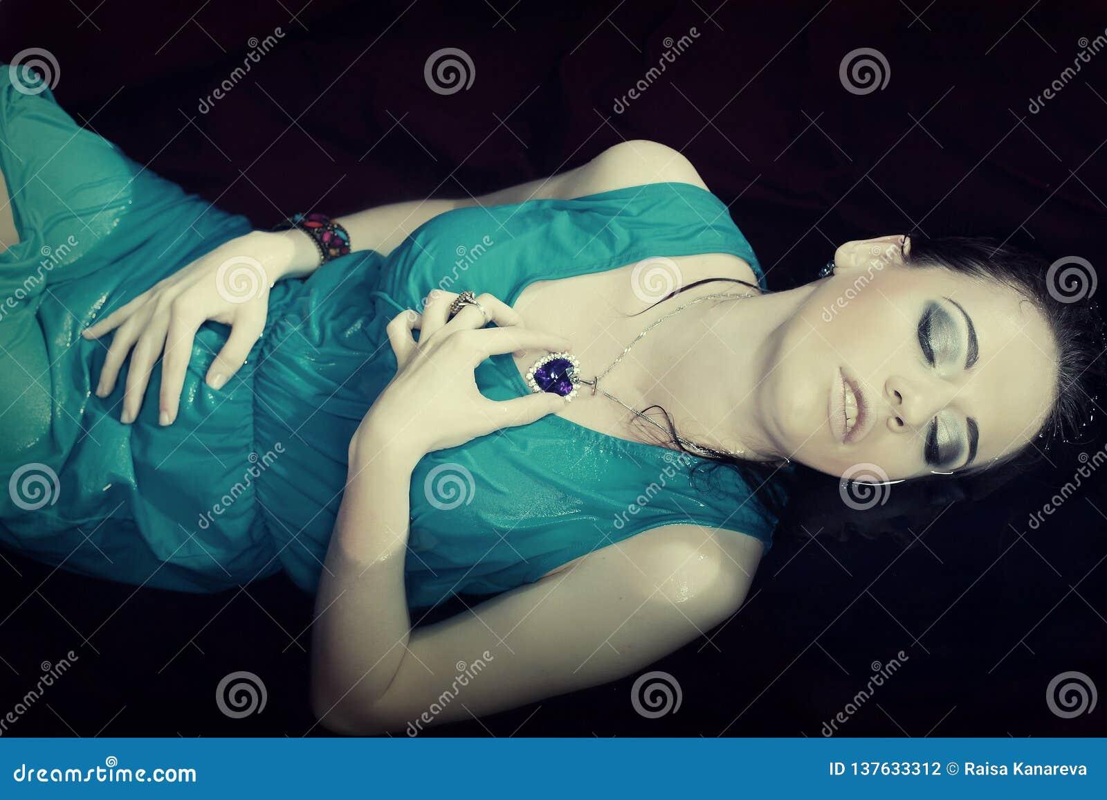 Woman in blue dress lying in water