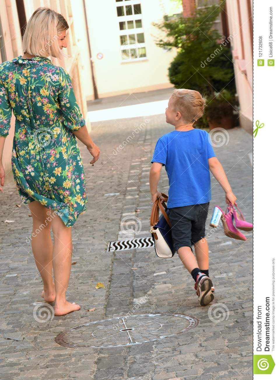 https://thumbs.dreamstime.com/z/young-woman-boy-women-dress-walking-barefoot-along-street-who-holding-sandals-purse-her-hand-121732608.jpg