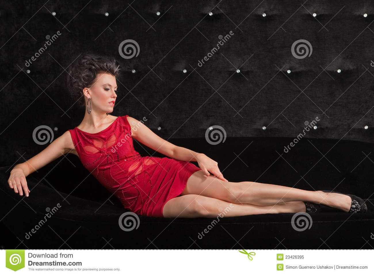 Young Woman Brunette In Red Dress Laying On Black Royalty