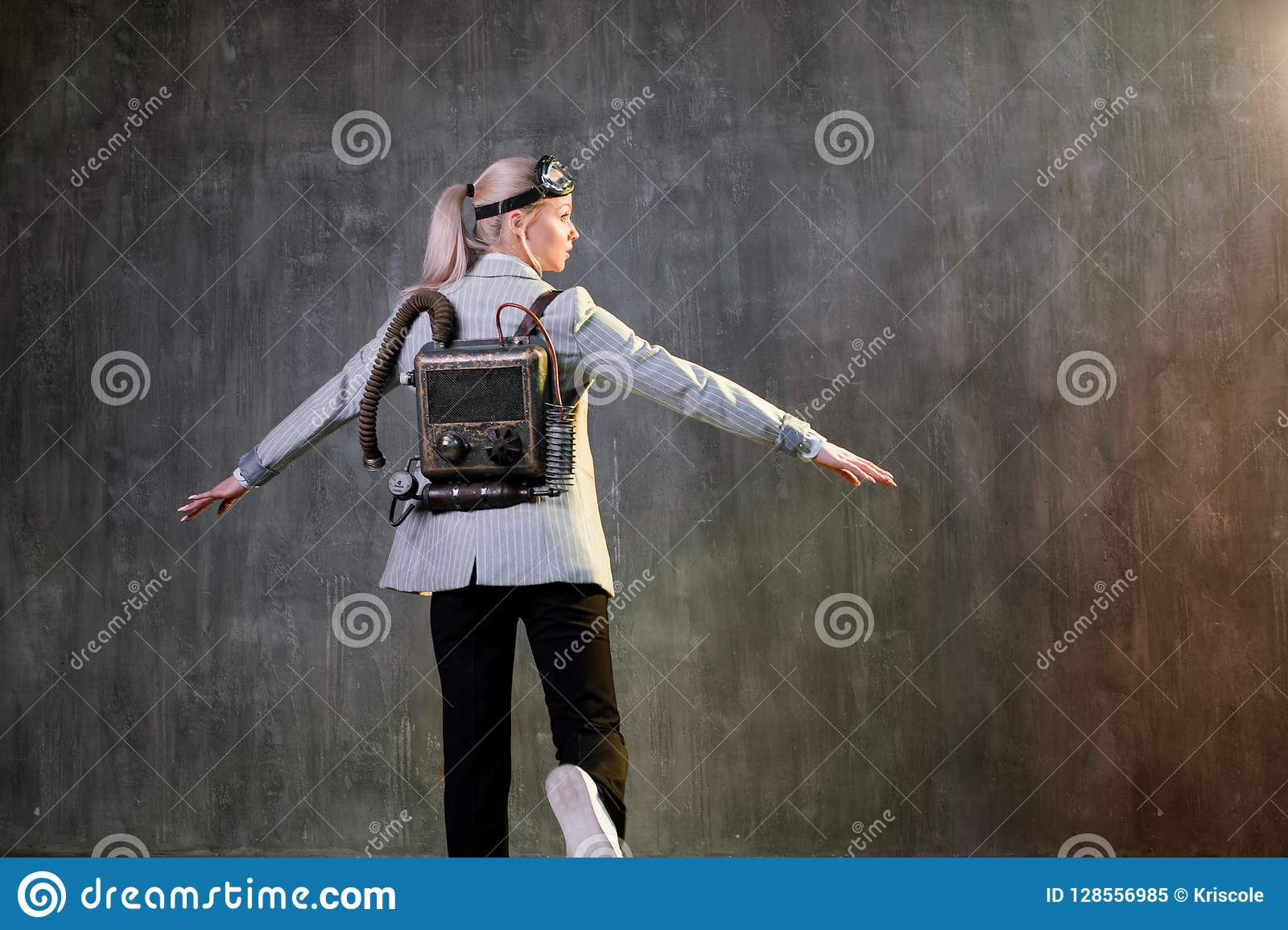 Young woman businesswoman with jetpack on the back. Business acceleration concept, startup, technology and development