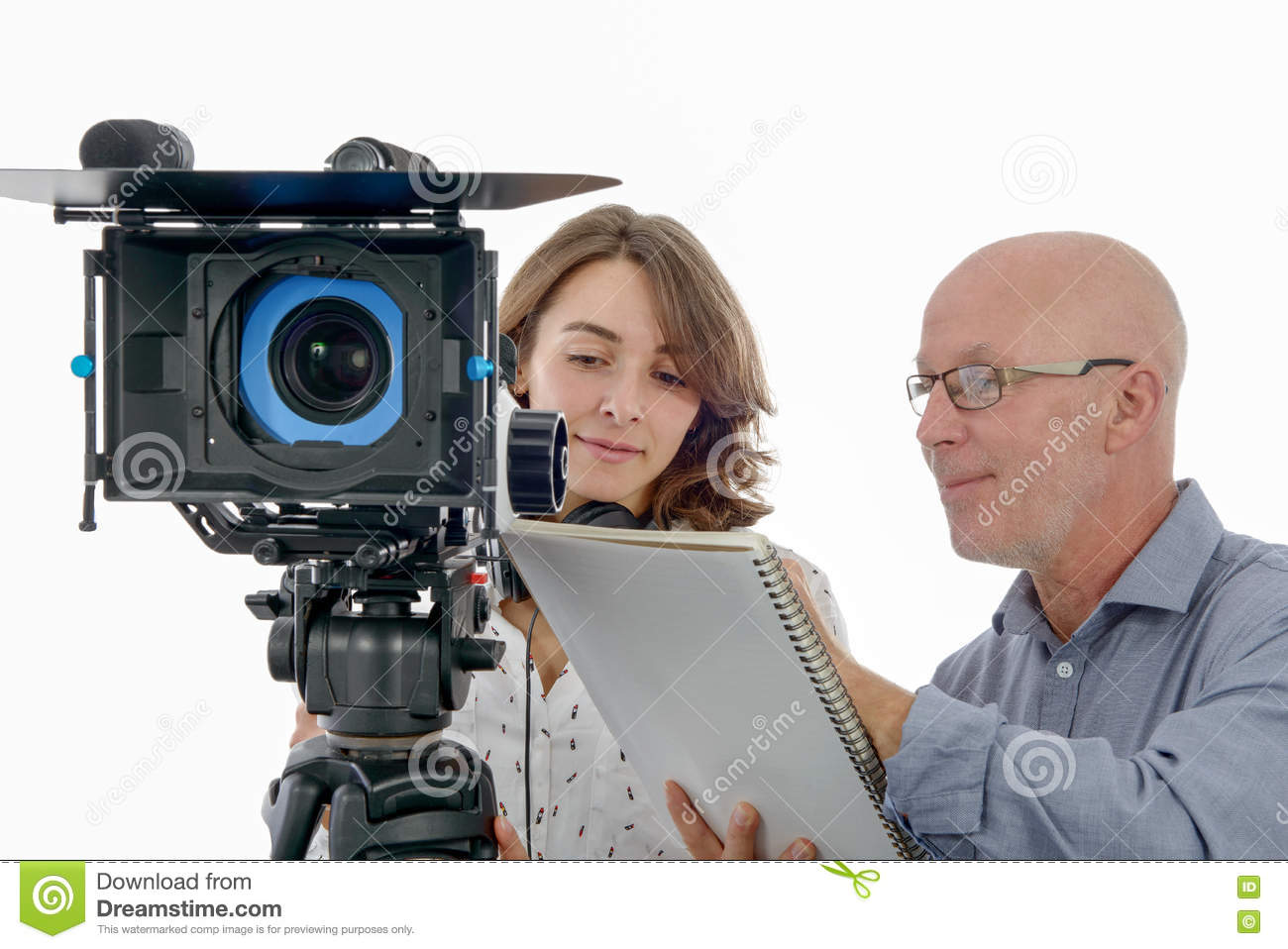Young woman cameraman and the mature man