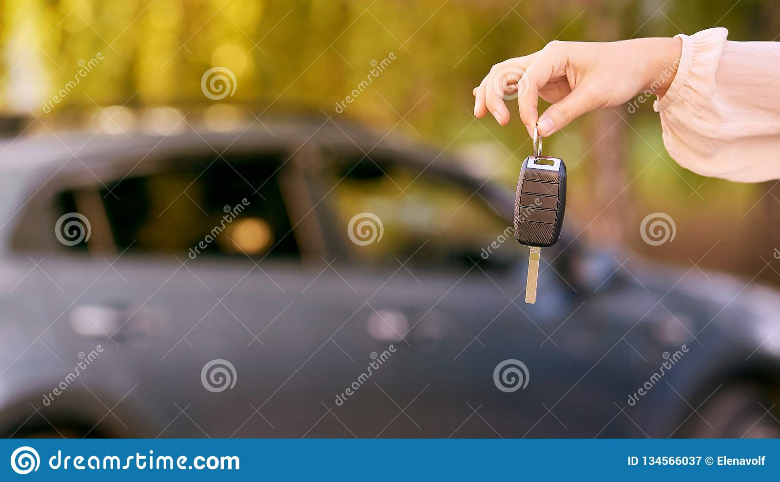 Young woman in car. Ride instruction. Automobile loan. Hand with key