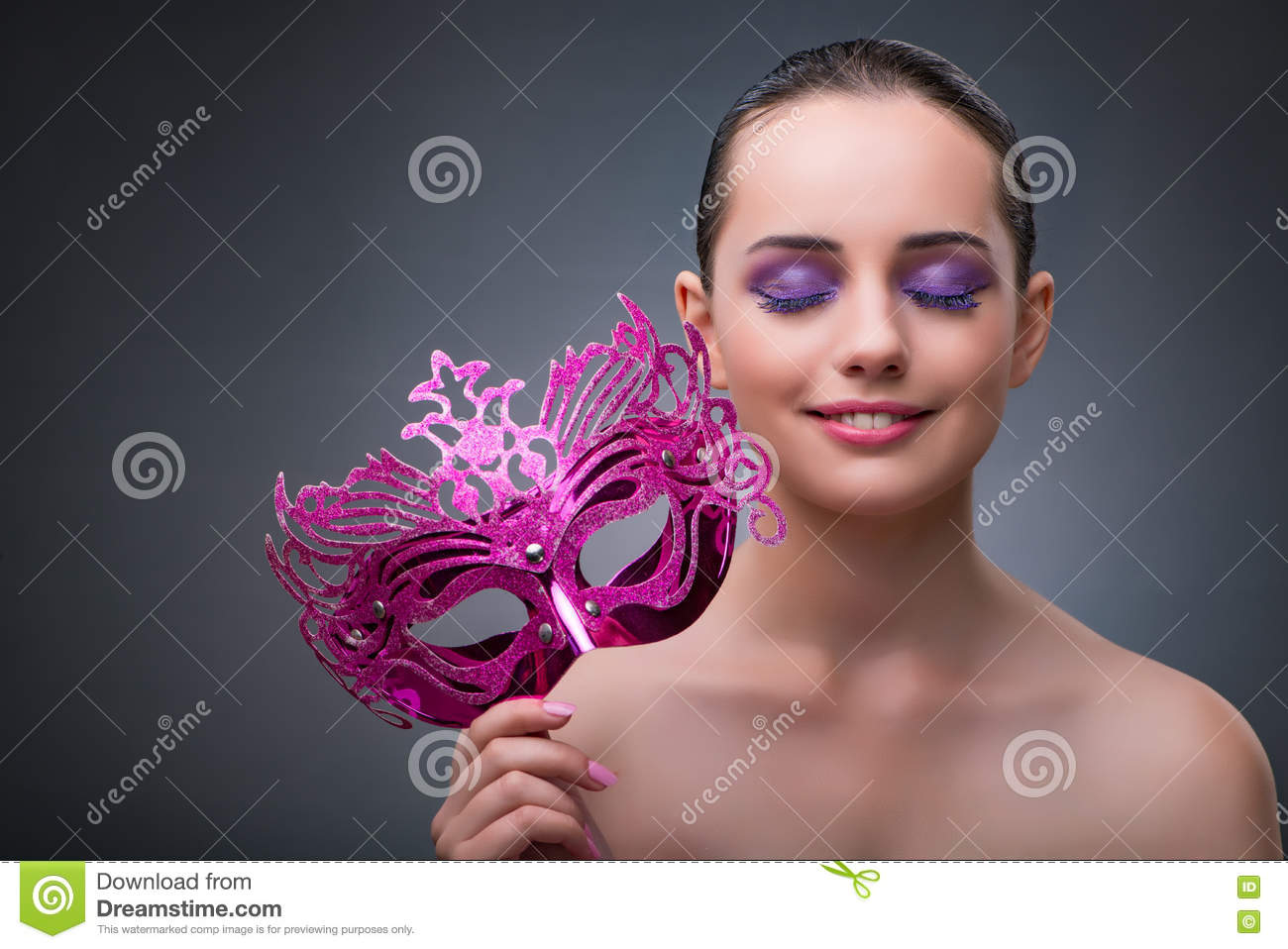 The young woman with carnival mask