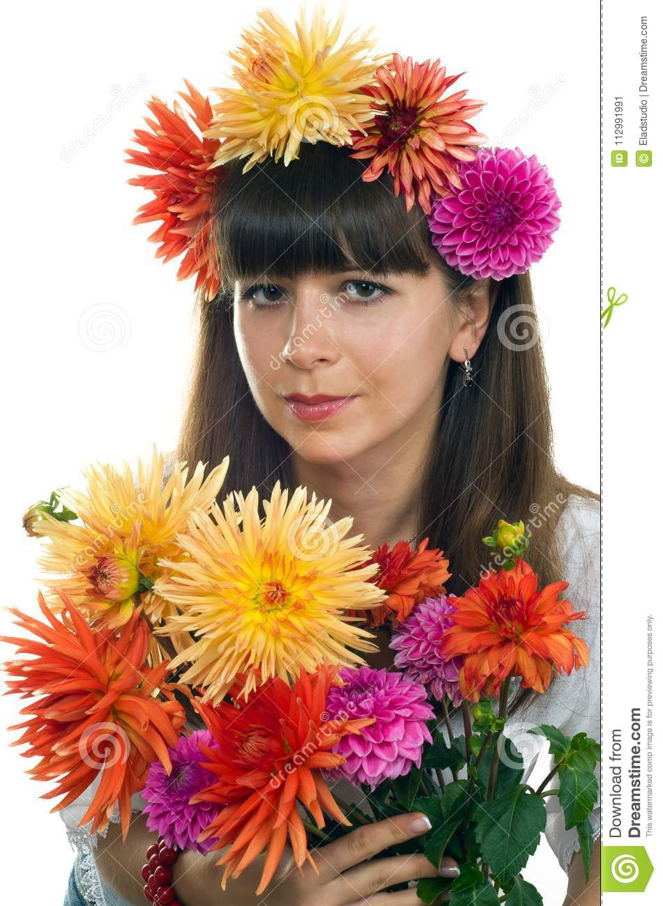 Young smiling girl with flowers dahlias
