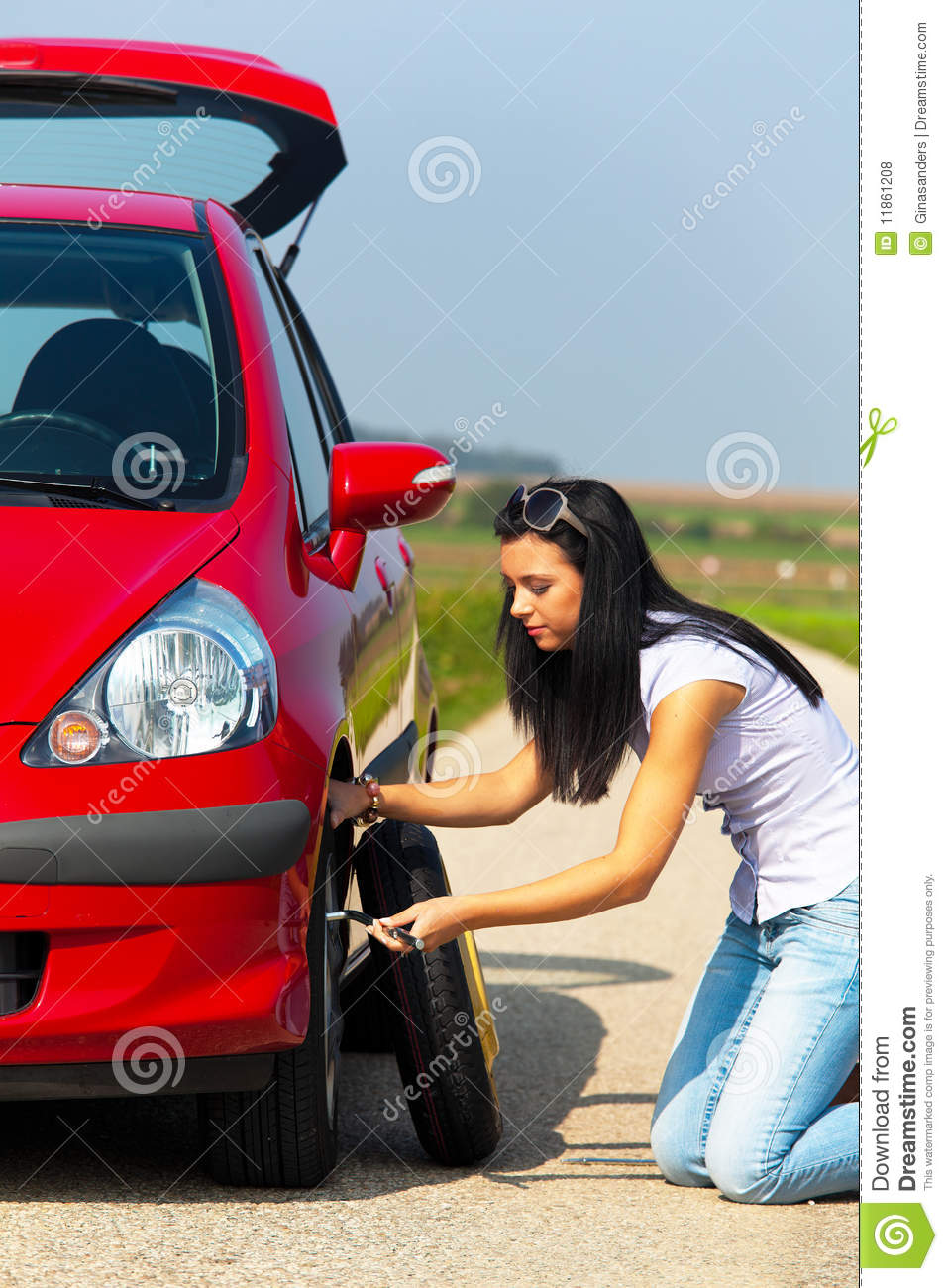 Young Woman Changing Tire Stock Photo Image Of Long