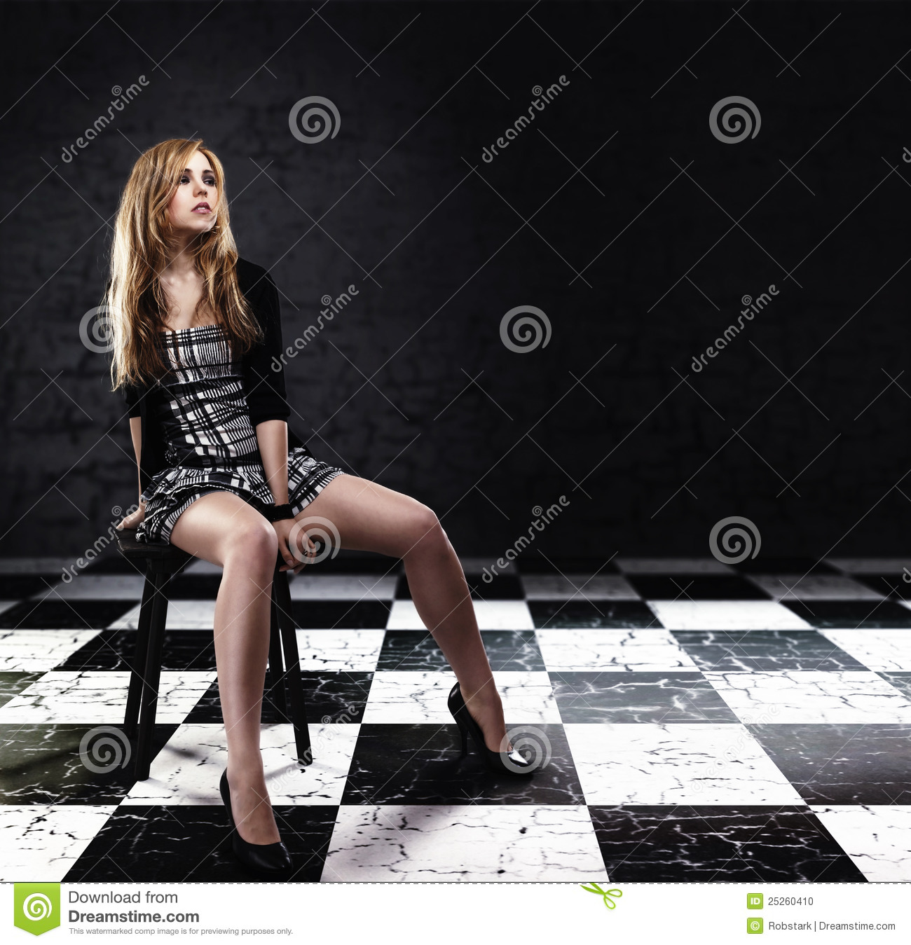 Brilliant Beautiful Woman Sitting On The Floor Wearing A Short Skirt  Isolated