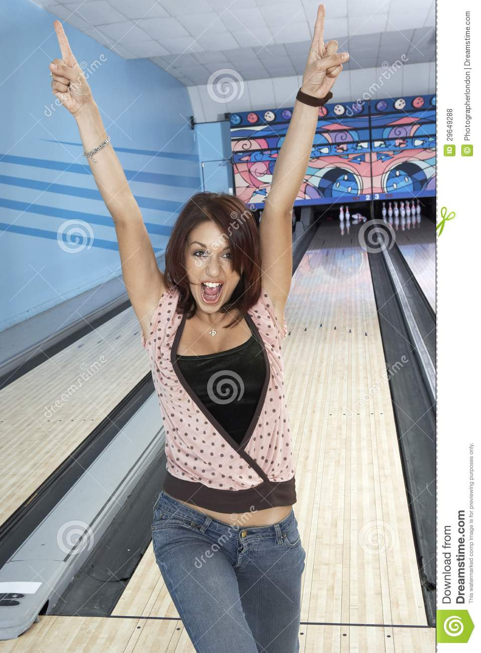 Young Woman Cheering At Bowling Alley Stock Photo Image