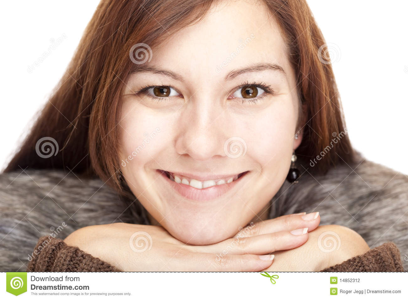 Young Woman with chin on hands smiles happy