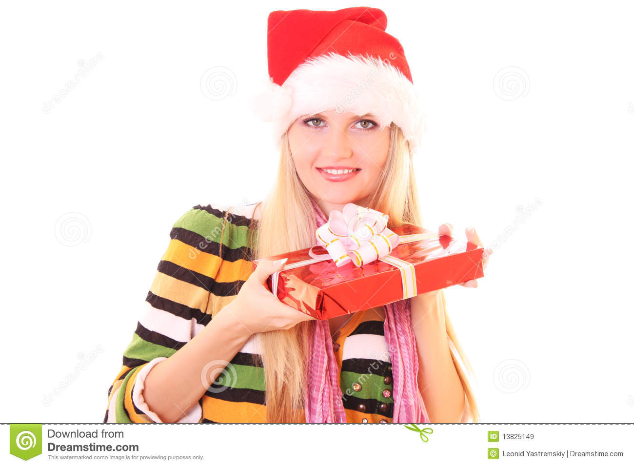 Young Woman With Christmas Hat And Gift Royalty Free Stock