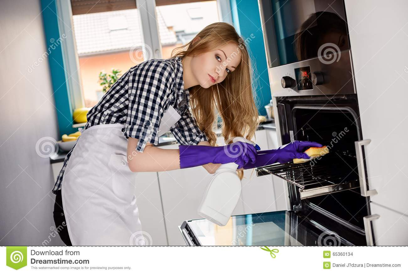 White apron girl - A Young Woman Cleans The Oven