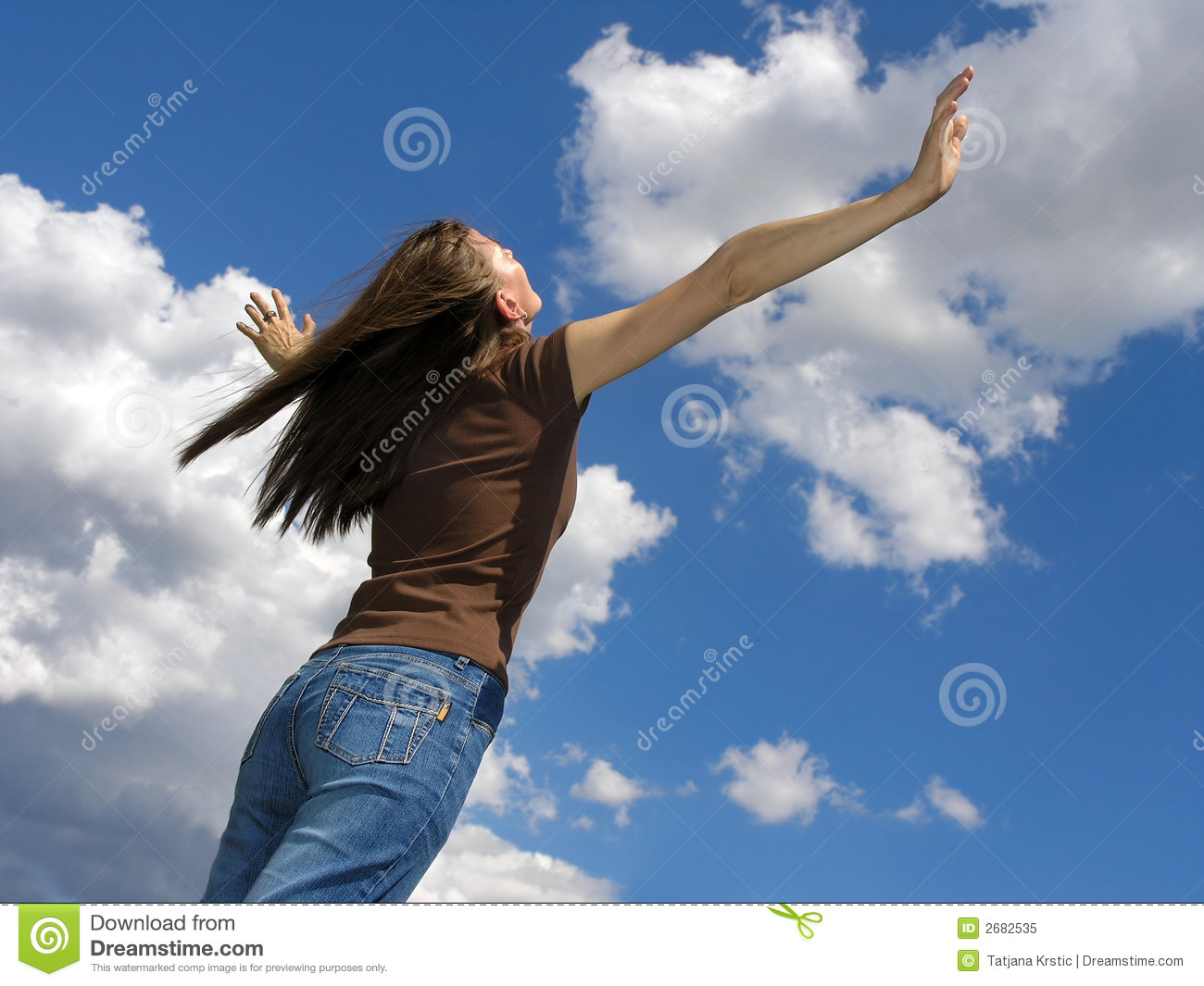 Young woman and clouds .