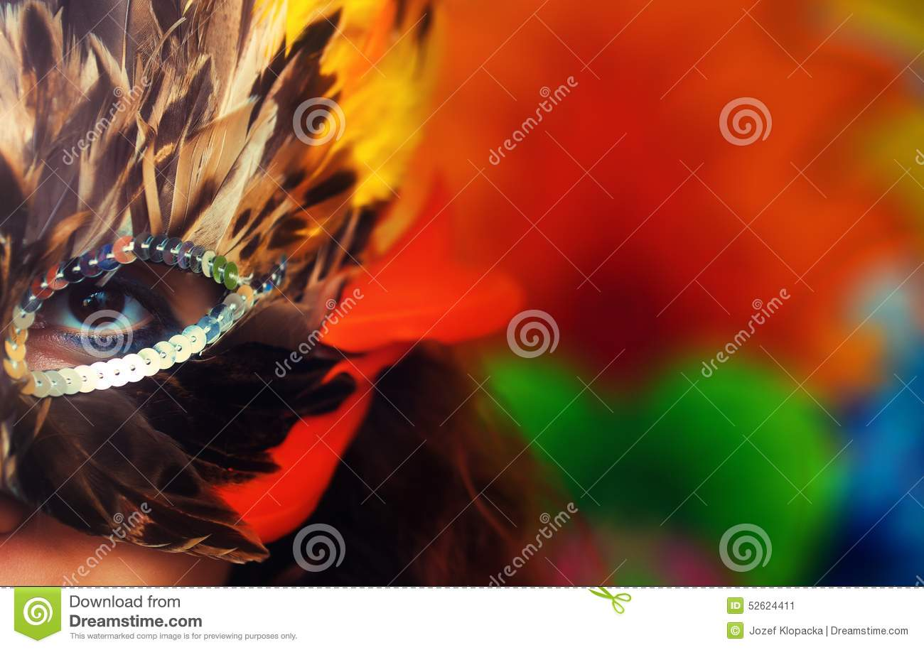 Young woman with a colorful feather carnival face mask on bright colorful  background d360c5b3d03