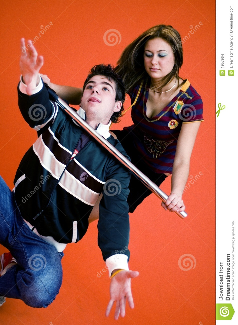 Pretty young woman with baton holds young man around the throat to ...