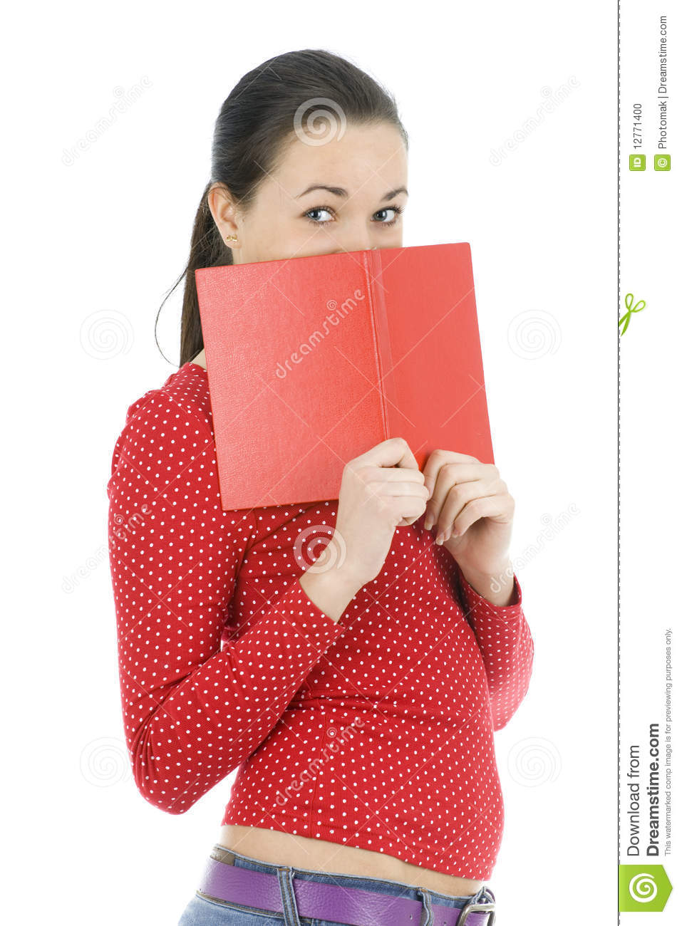 Book Covering Face : Young woman covering face by red book stock photo image