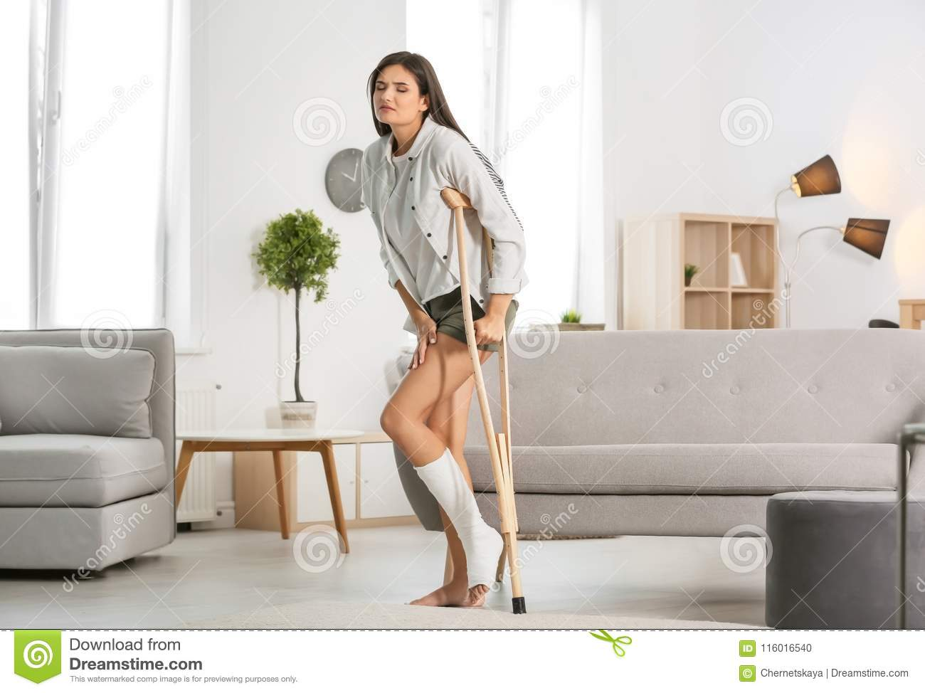 Young Woman With Crutch And Broken Leg In Cast Stock Photo ...
