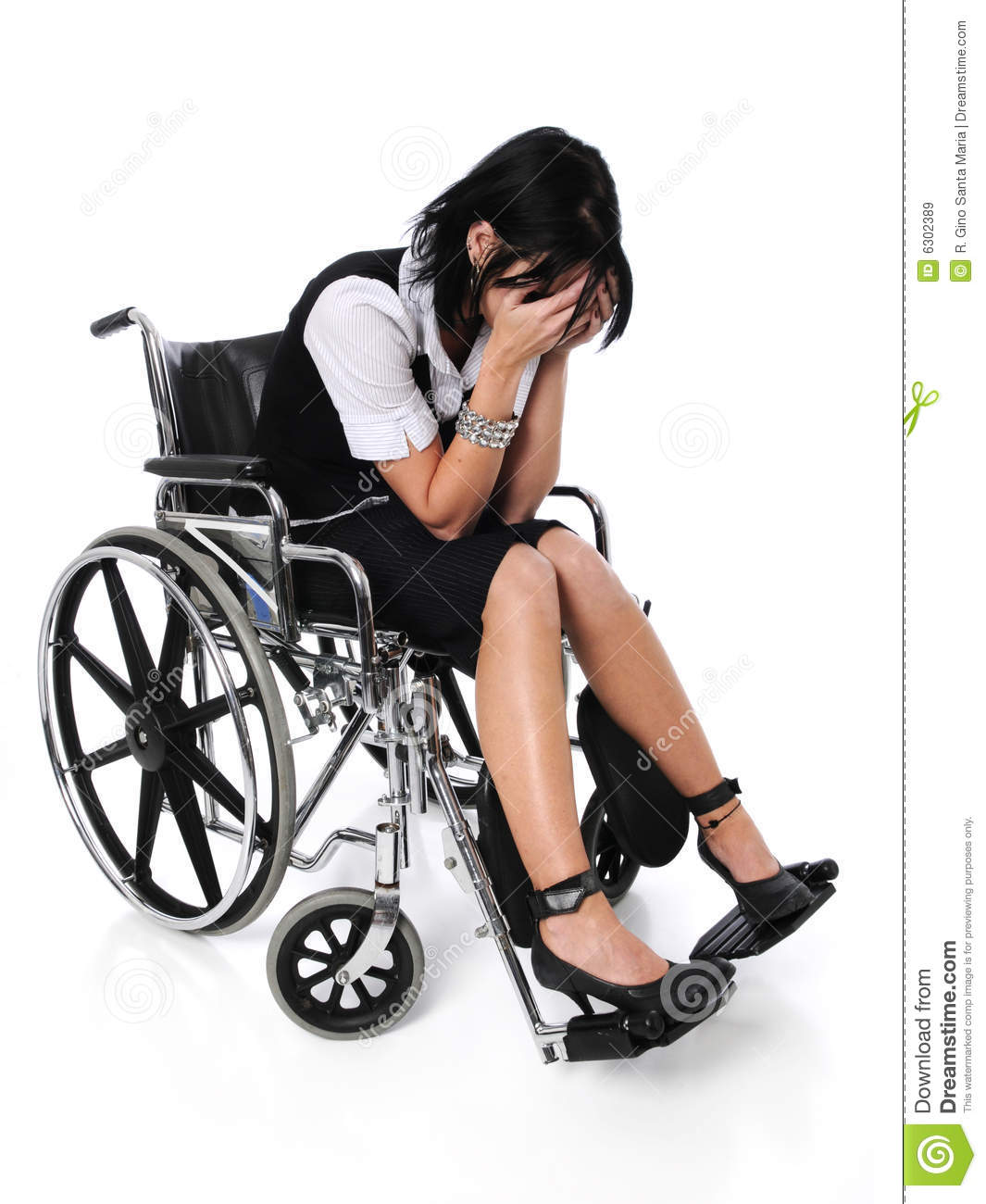 Young Woman Crying Sitting On A Wheelchair Stock Image