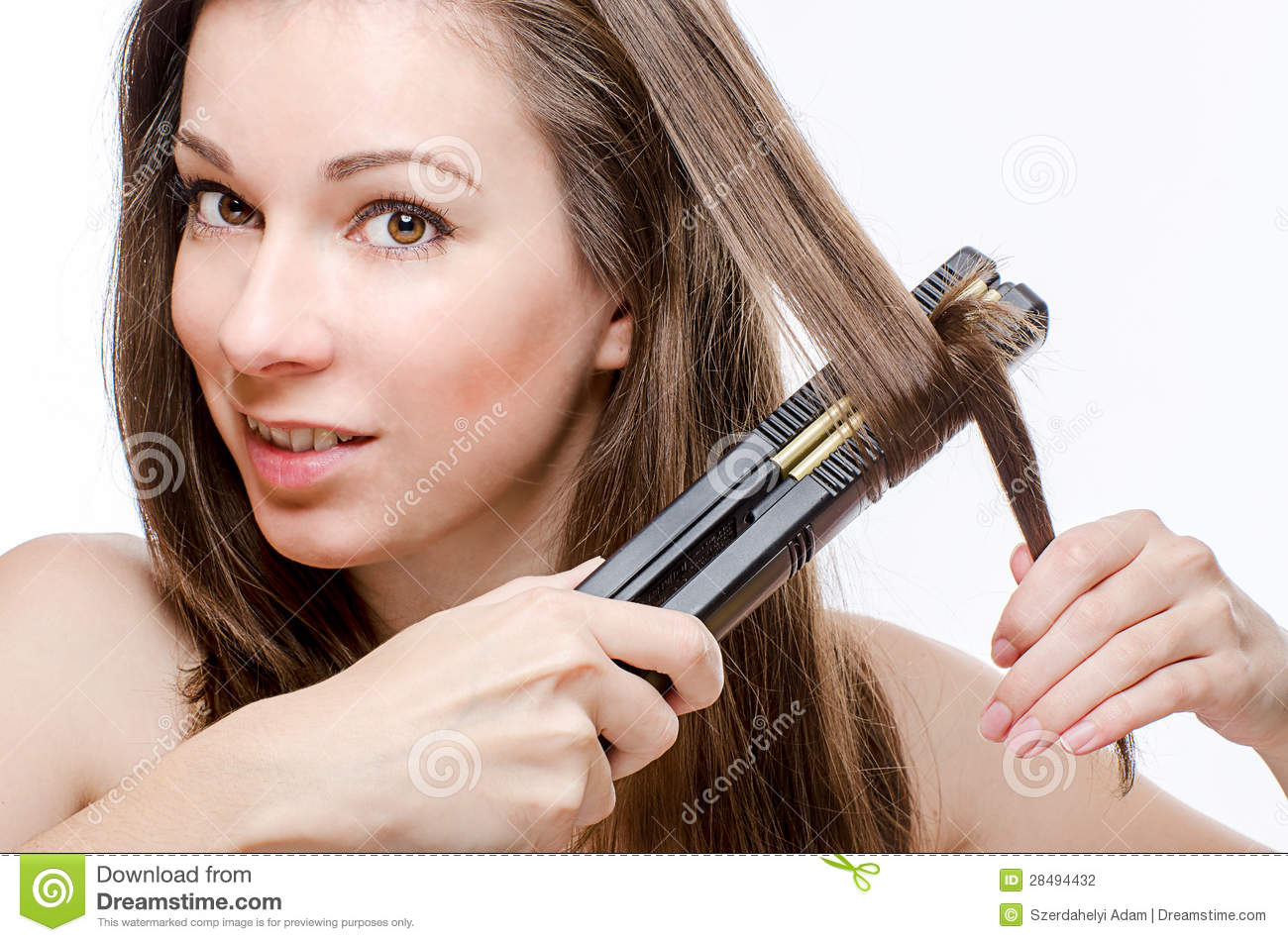 Young Woman Curling Hair With Hair Straightener Stock Photo - Image: 28494432
