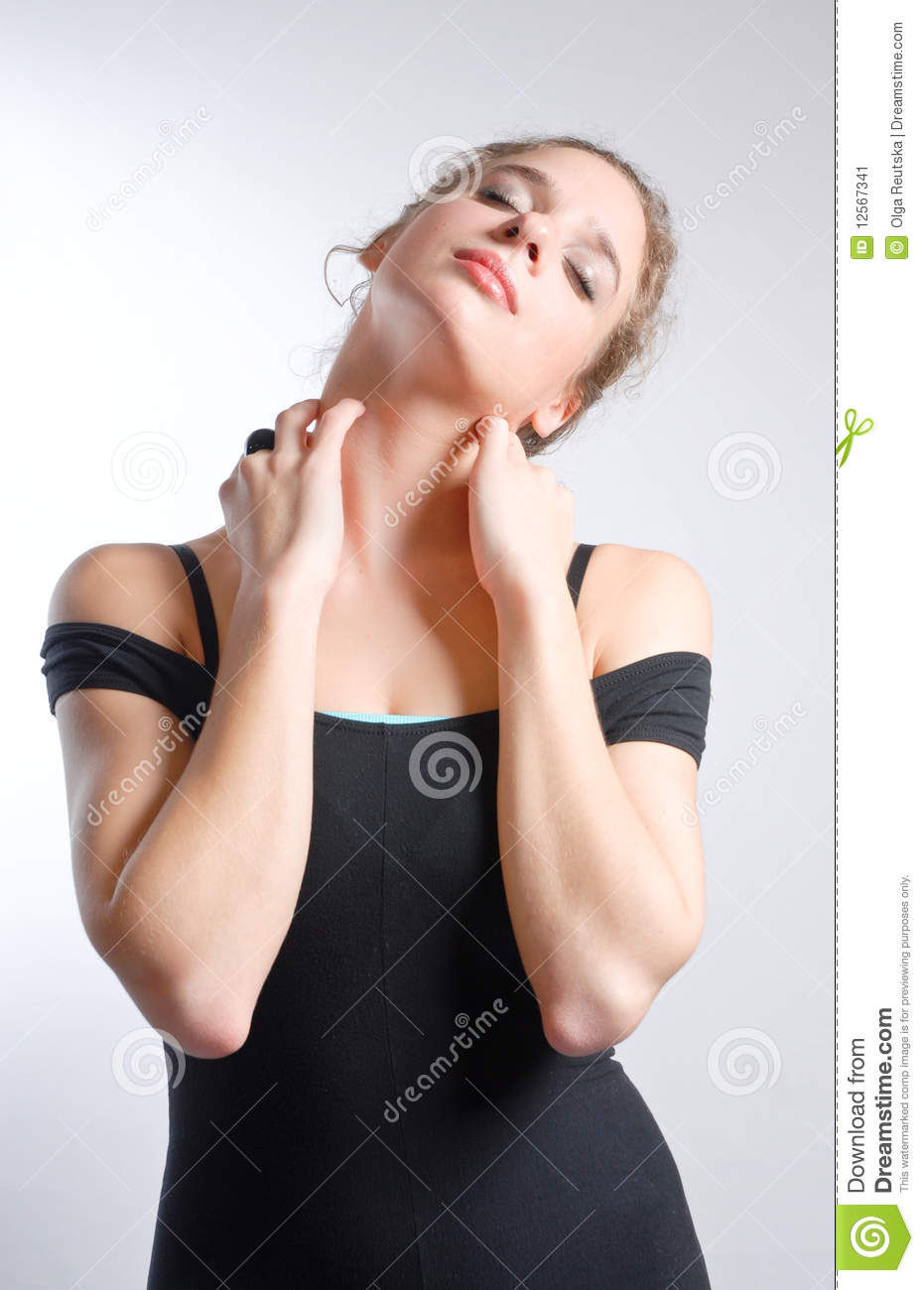 Young woman in dancer s leotard stretching neck