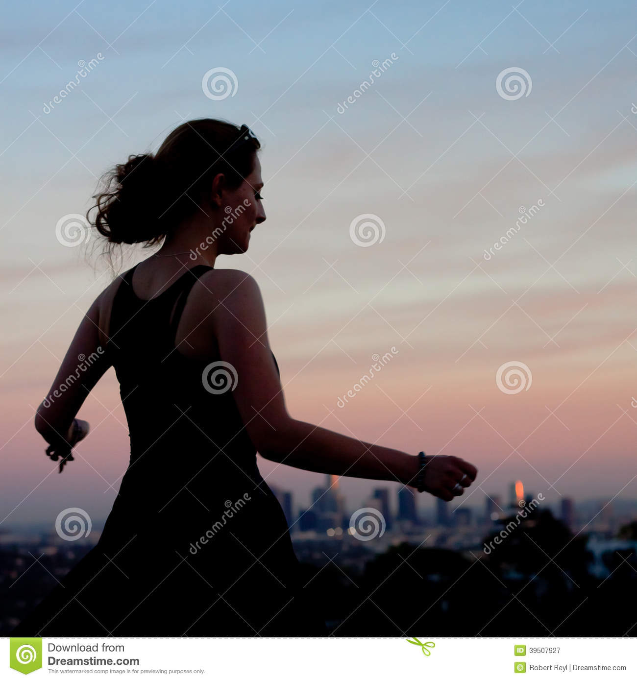 Young woman dancing in the sunset