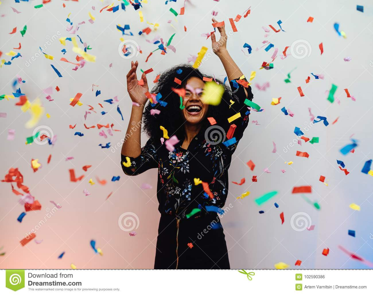 Download Young Woman Dancing Under Confetti At Home Stock Photo - Image of raised, dancing: 102590386