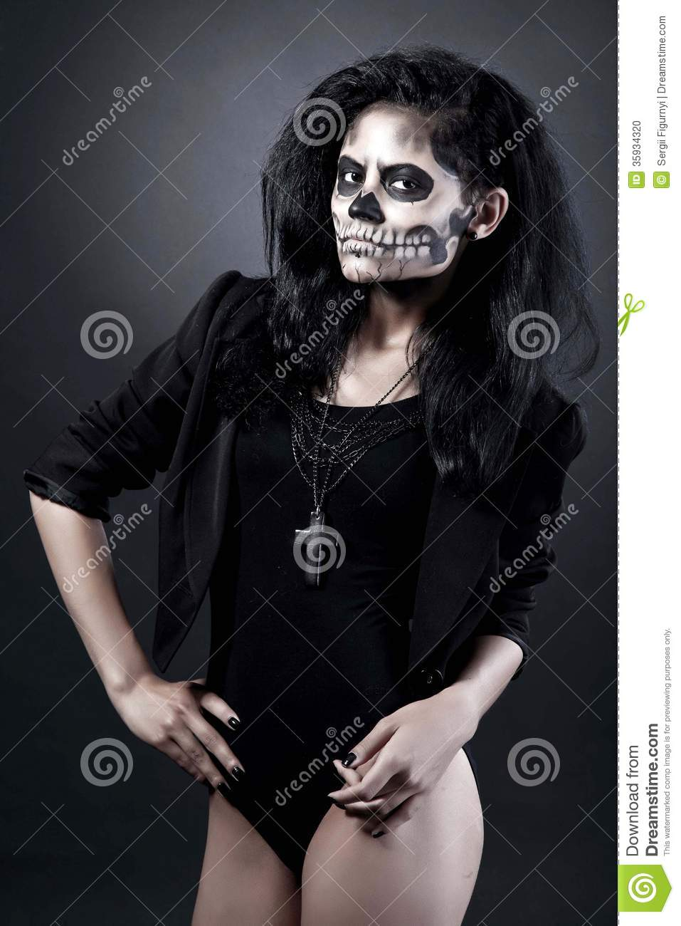 download young woman in day of the dead mask skull halloween face art stock photo