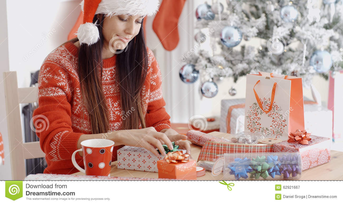 Young Woman Decorating Her Christmas Gifts Stock Photo