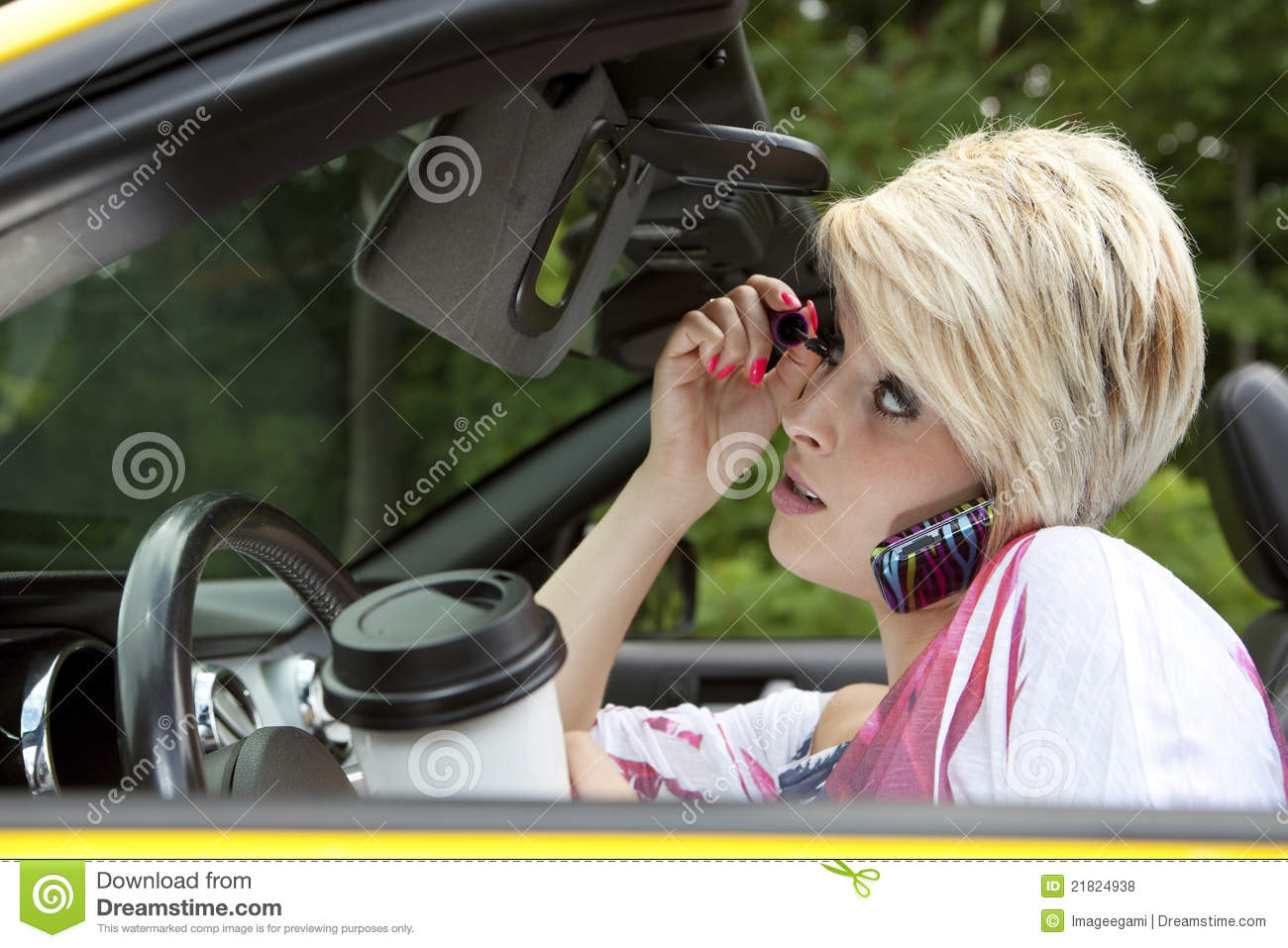 Young woman distracted while driving