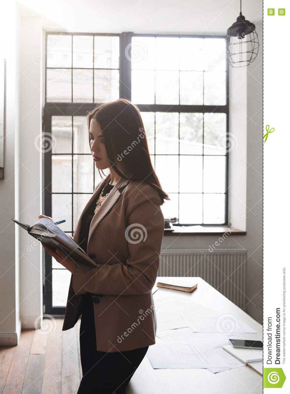 Young woman does inventory of company supplies