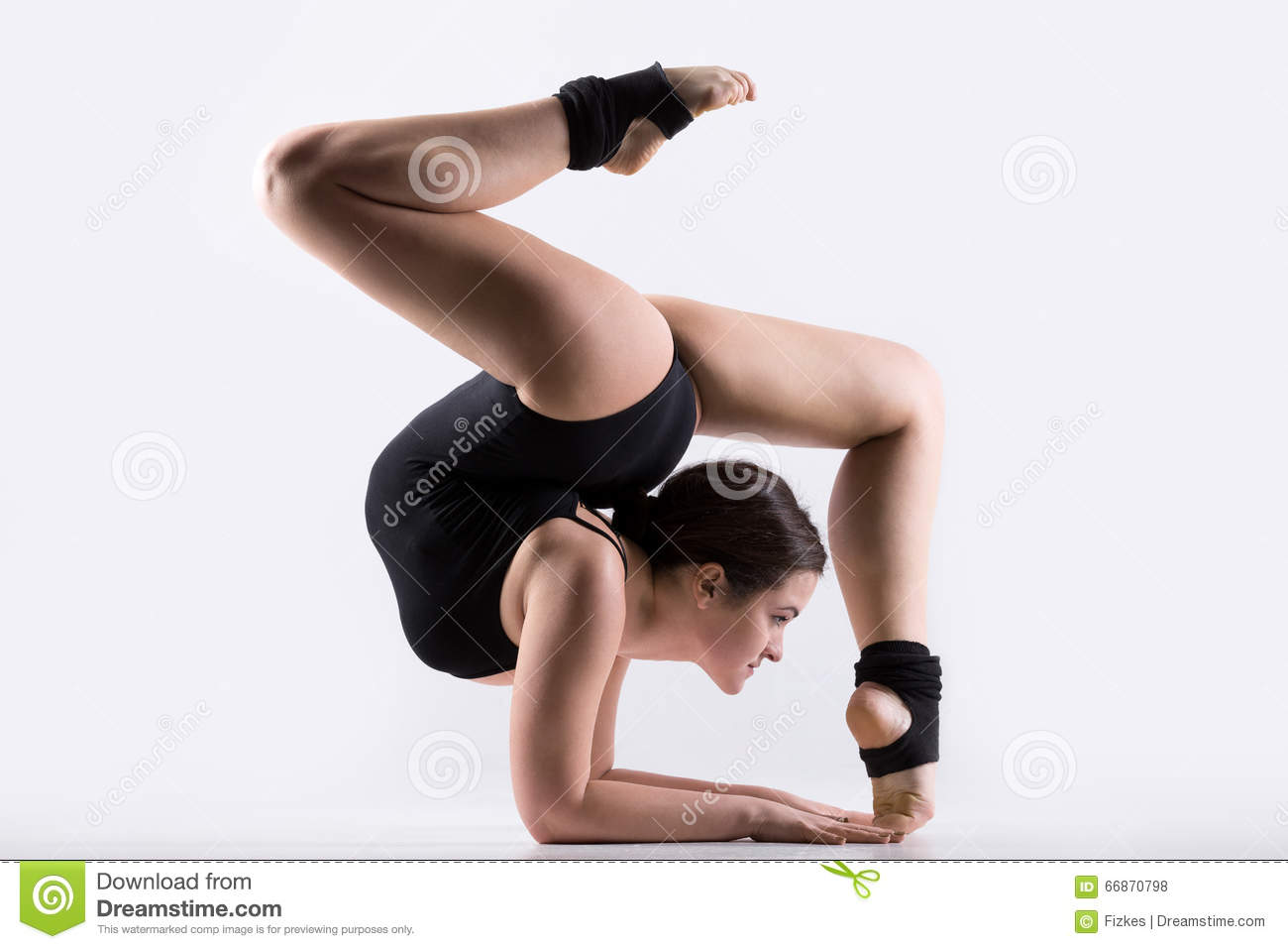 Young Woman Doing Gymnastics Handstand Exercise Stock ...