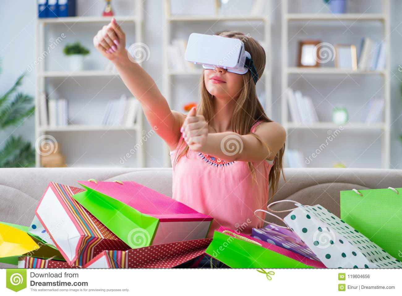 The young woman doing shopping with virtual reality glasses