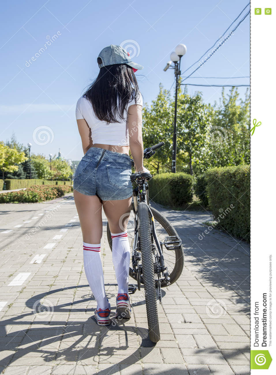 Young woman doing sports on the bike