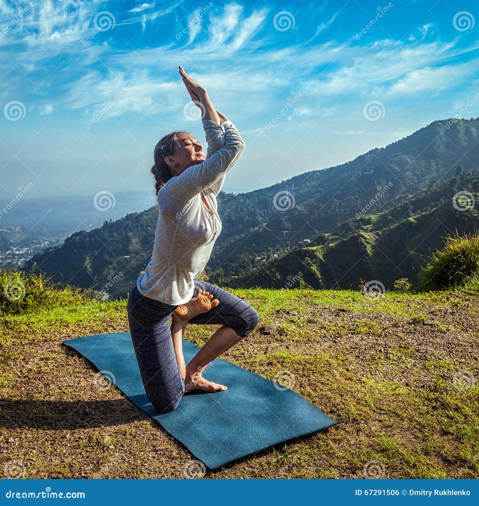 Young Woman Doing Yoga Advanced Asana