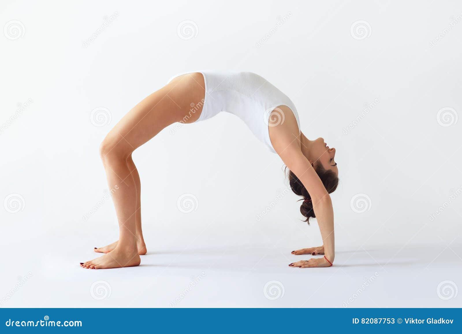Young woman doing yoga asana Upward Bow Wheel Pose