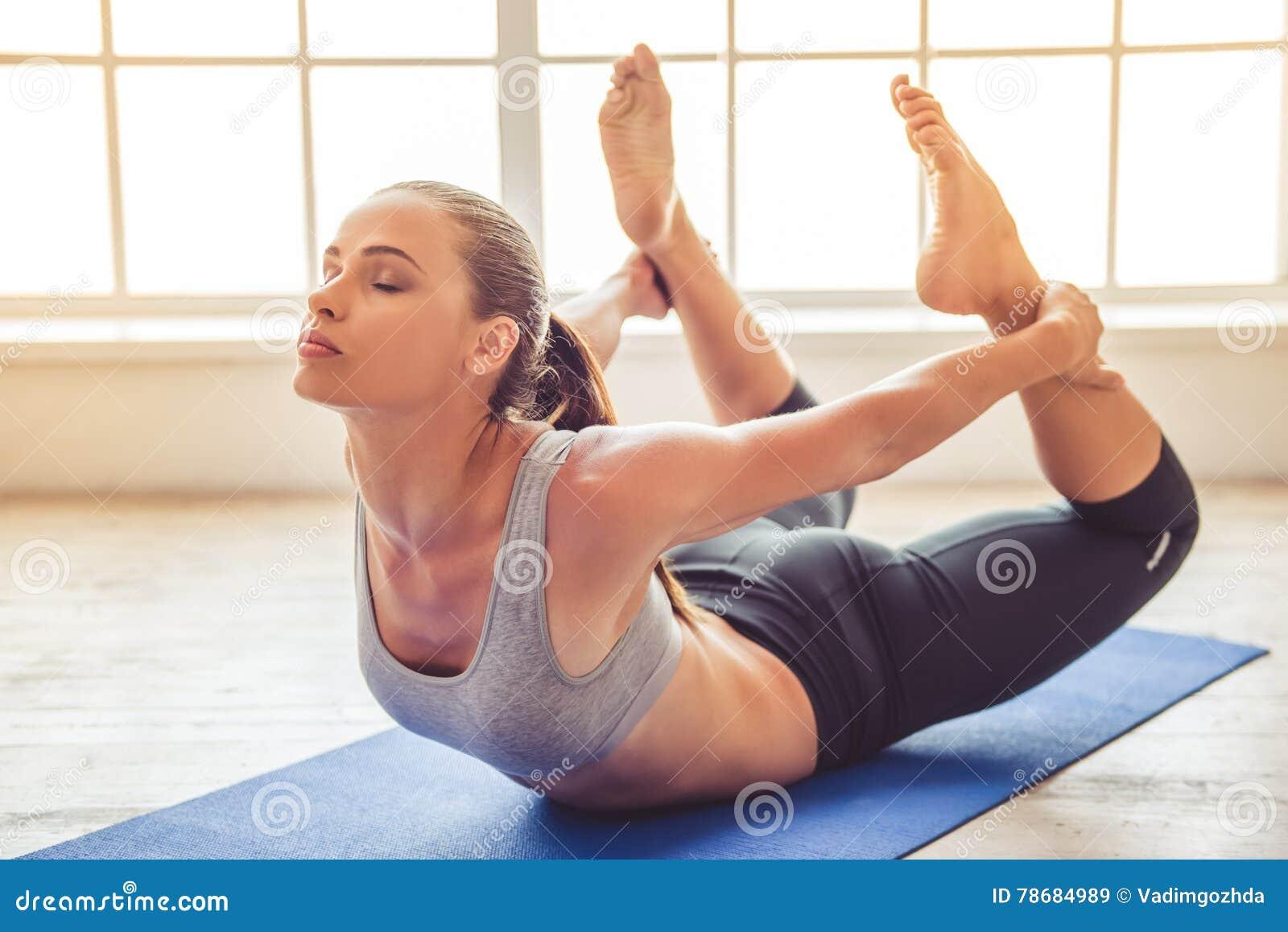 young beautiful pregnant woman doing yoga stock photo