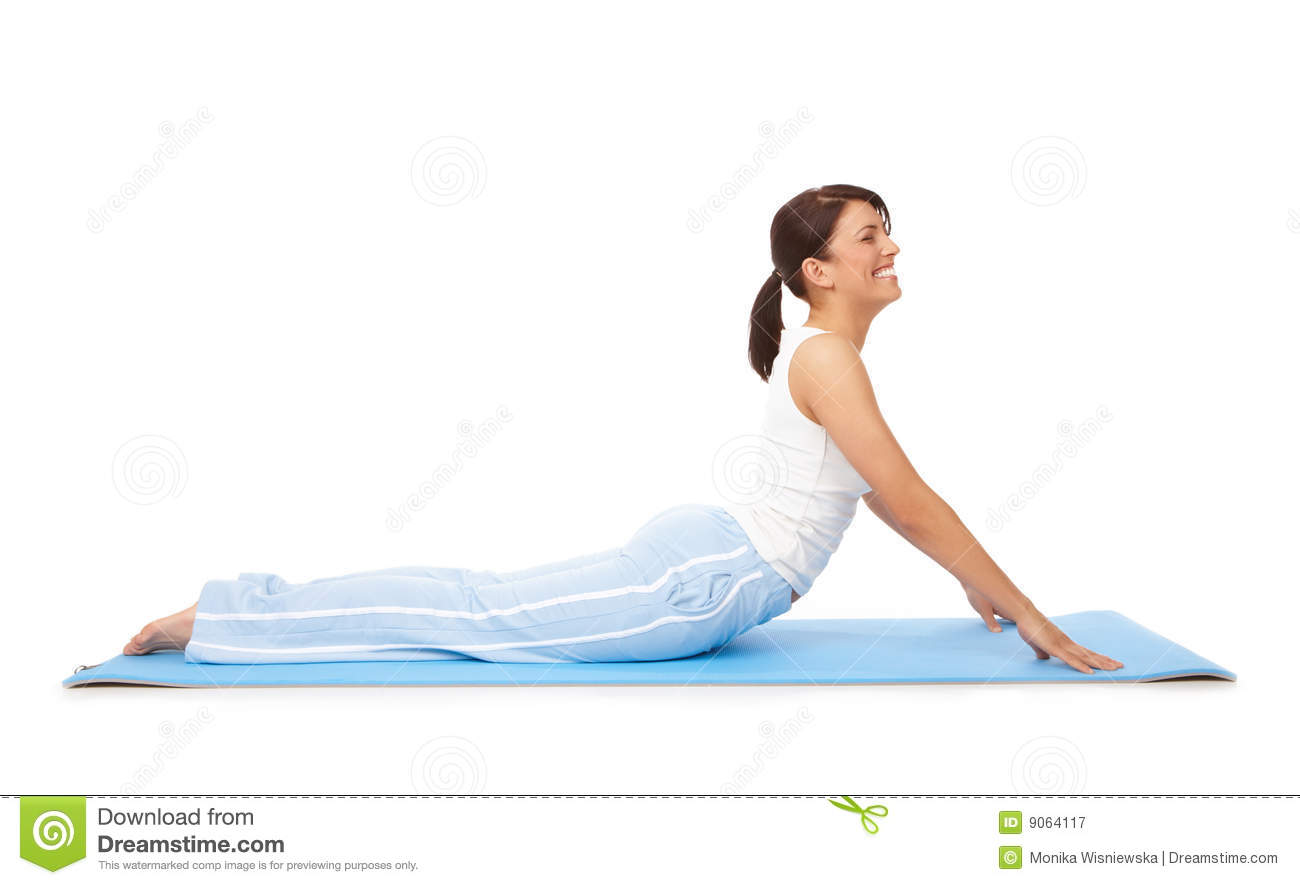 Young Woman Doing Yoga Or Pilates Exercise On Mat Royalty
