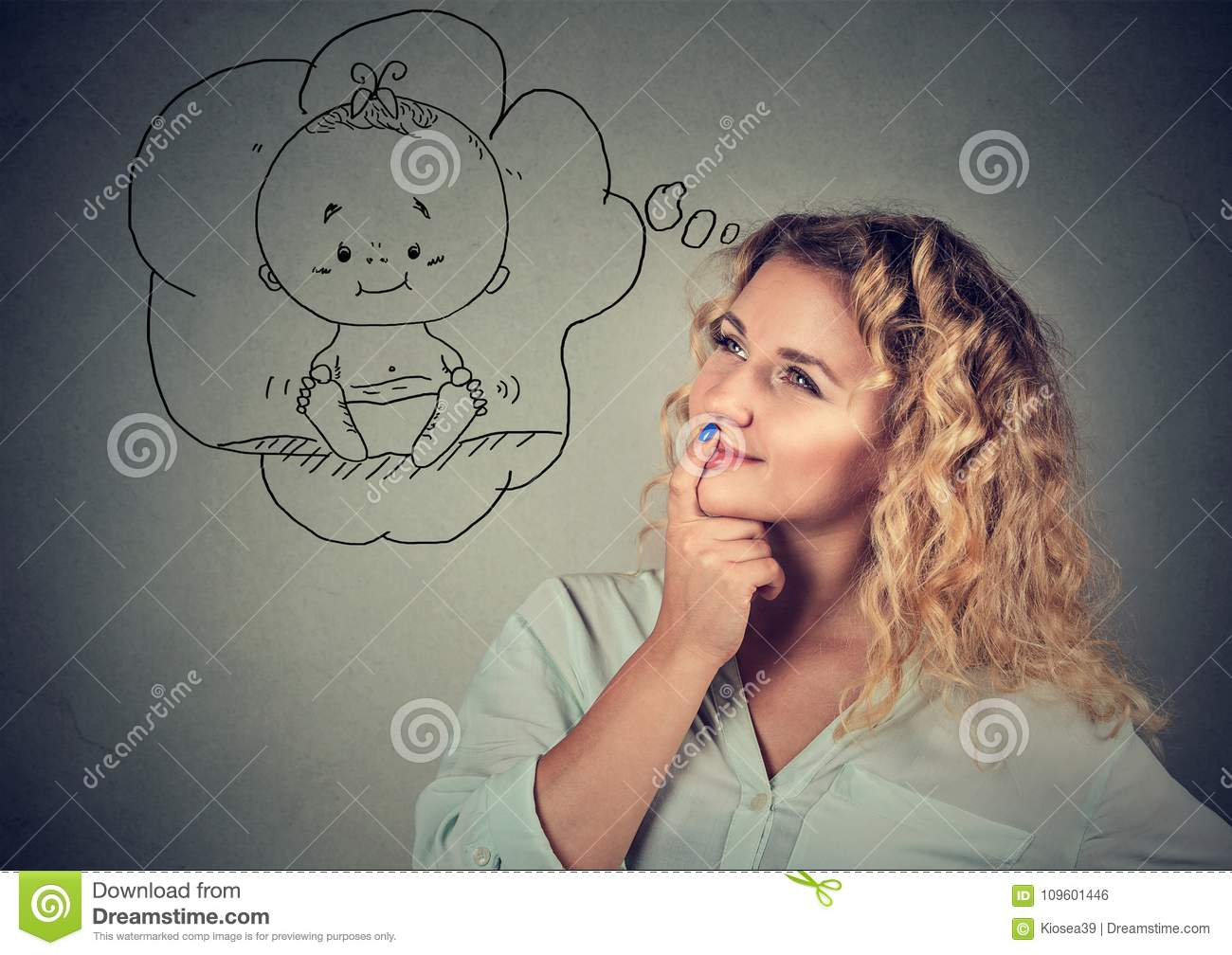 Young woman dreaming of baby