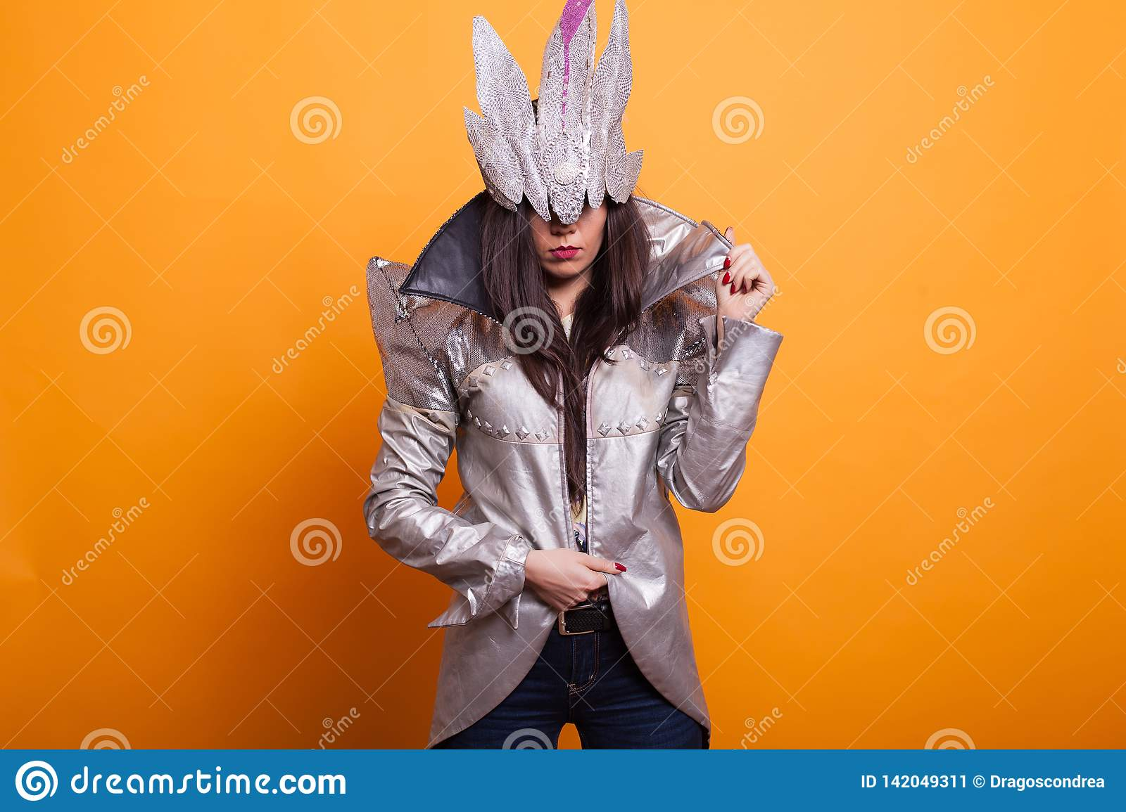 Young woman dressed in spooky halloween costume over yellow background