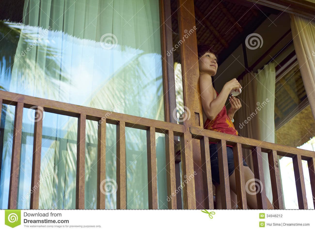 Young woman drink coffee on balcony stock photo image of for What is a balcony