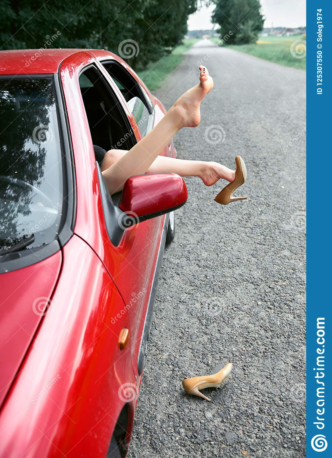 Young Resting Car Red CarPut Feet Driver In Woman The On A